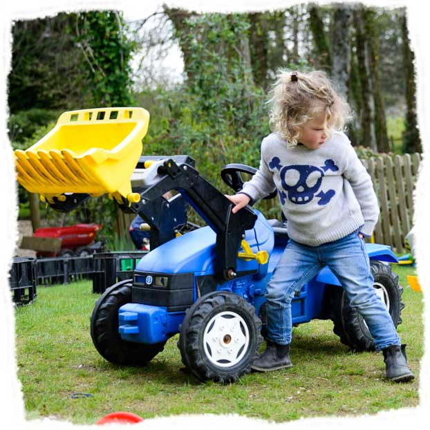 Having fun playing with a ride on digger